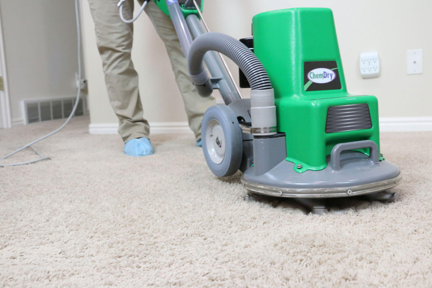 man with powerhead cleaning carpet